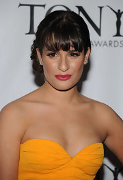 Lea Michele showed off saturated red lips and an elegant updo.