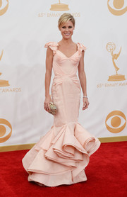 Julie looked sweet as can be in a structured, creamy pink mermaid gown.