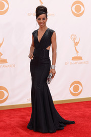 Shaun Robinson chose an elegant black dress with a deep V-neck and side cutouts for the Emmy Awards.