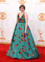 Lena turned heads in a floral-printed gown with a V-neck bodice that tied in the back.