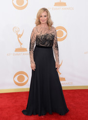 Jessica took to the carpet in a black flowing skirt and nude bodice with black, sequined embellishment.