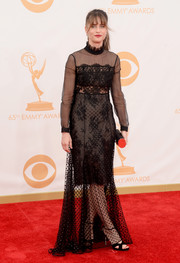 Amanda Peet chose a long-sleeve lace overlay dress for her red carpet look at the 2023 Emmy Awards.