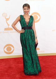 Sarah showed off her mature style when she wore this emerald green gown that featured a black lace overlay.
