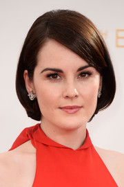 Michelle rocked a classic short bob parted on the side at the 2013 Emmy Awards.
