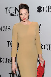 Tammy Blanchard's tomato red suede clutch perfectly complemented her minimalist camel dress.