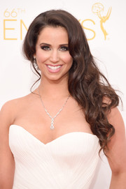 Syd Wilder glammed up her look with a curly side sweep for the Emmys.