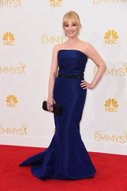 The 'Big Bang Theory' actress looked chic in a navy strapless gown with flared skirt, and she accented with black embellished accessories.