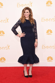 Natasha Lyonne exuded classic elegance at the Emmys in a navy Opening Ceremony lace cocktail dress with a flirty mermaid-style hem.