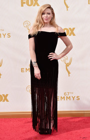 Natasha Lyonne went for hippie glamour at the Emmys in a black off-the-shoulder dress with a fringe skirt.