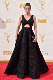 Amanda Peet enchanted in a richly textured black cutout ball gown by Michael Kors during the Emmy Awards.