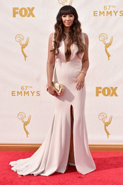 Jackie Cruz took a daring turn in a mega-plunging, high-slit gown by Christian Siriano during the Emmy Awards.