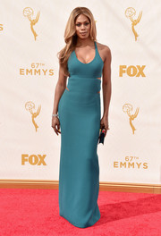 Laverne Cox made jaws drop at the Emmys in a petrol-blue Calvin Klein column dress boasting a cleavage-flaunting neckline and side and back cutouts.