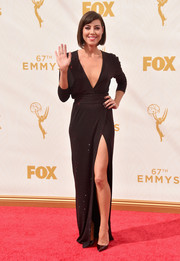 Aubrey Plaza put on a sultry display on the Emmys red carpet in a plunging, high-slit wrap dress by Alexandre Vauthier.