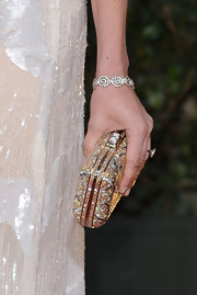 Calista Flockhart added some sparkle to her red carpet look with this glamorous gold and silver clutch.
