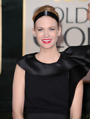 This simple black silk headband adds an extra touch to January Jones' look.
