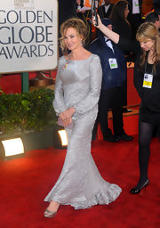 Jessica Lange simply shined in a silver evening dress with a rich wave texture.
