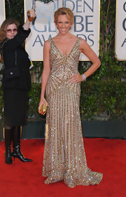 It's hard to go wrong when you wear  Elie Saab on the red carpet. Toni simply glows in a beaded gold gown.