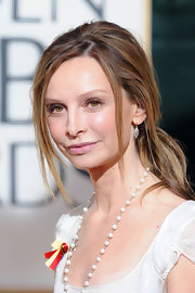 Calista Flockhart opted for a messy ponytail for her red carpet look at the 2010 Golden Globes.