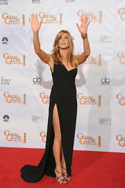 Super sexy and super strappy - Aniston wore these black evening sandals to the Golden Globes.