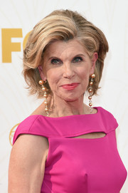 Christine Baranski styled her hair into a teased bob for the 2015 Emmys.