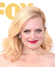 Elisabeth Moss channeled Barbie with her half-pinned blonde waves at the Emmy Awards.