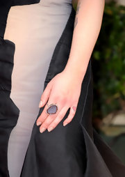 Kelly Osbourne paired her gown with a sparkling gemstone ring.