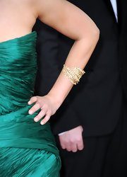 Mila Kunis was a knock out in her emerald green dress. She paired her winning look with a gold leaf bracelet.