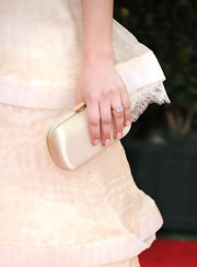 Kaley Cuoco paired her delicate dress with just the right color polish. A soft shade of pink completed her flawless look.