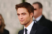 Girls around the world waited with bated breath for Robert Pattinson to arrive on the red carpet at the 2011 Golden Globes. And when he did (sigh!) RPatts debuted a brand new hairdo! What do you think of the Twilight star's newly tinted red locks? You likey?