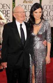 Wendi Deng styled her Golden Globe Awards look with a glam black gemstone necklace.
