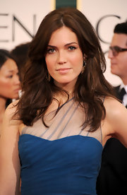 Many More wore long curls to the 2011 Golden Globe Awards. Her chocolate tresses were a nice contrast to her teal dress.