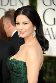 Catherine Zeta Jones always looks elegant on the red carpet. The actress completed her stunning look with center part waves.