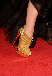 Olivia Wilde took a walk on the wild side in gold spiked Christian Louboutin cutout booties.