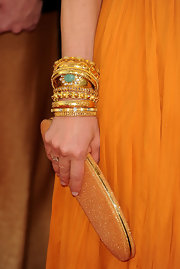 Kyra Sedgwick paired her mustard yellow dress with exquisite bangle bracelets.