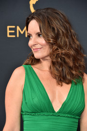 Tina Fey wore her hair down to her shoulders in high-volume curls during the Emmys.