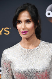 Padma Lakshmi looked youthful and oh-so-pretty wearing this ponytail with parted bangs at the Emmy Awards.
