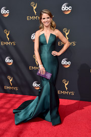 Natalie Morales looked breathtaking at the Emmys in a strapless emerald mermaid gown with an angular neckline.