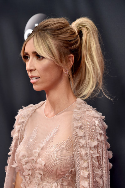 Giuliana Rancic sported a messy ponytail with parted bangs at the Emmy Awards.