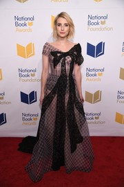 Emma Roberts hovered between sweet and sultry in a sheer Ulyana Sergeenko Couture gown, featuring a gingham pattern with black lace bow detail, at the National Book Awards.
