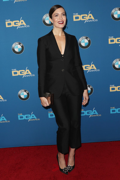 Mandy Moore accessorized with a gold Lee Savage clutch for a bit of shine to her black outfit.