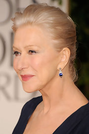 Helen Mirren attended the 69th Annual Golden Globe Awards wearing a pair of 1950s sapphire and diamond pendant earrings in platinum.