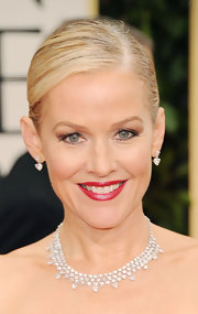 Penelope Ann Miller wore a rich ruby red lipstick with pearlescent finish at the 69th Annual Golden Globe Awards.