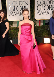 Natalie Portman chose an unexpectedly bright color on the red carpet wearing a hot pink taffeta gown with a side bustle.