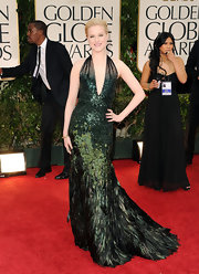 Evan Rachel Wood was simply breathtaking in a an emerald feathered evening dress at the Golden Globe Awards.