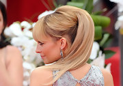 Nicole Richie wore her hair in a half-up, half-down style with long lash-grazing bangs at the 69th Annual Golden Globe Awards.