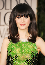 Zooey Deschanel wore her hair in long smooth strands with lots of volume and sexy lash-grazing bangs at the 69t Annual Golden Globe Awards.