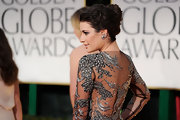 Lea Michele wore her curly hair in a loose French twist at the 69th Annual Golden Globe Awards.