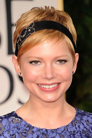 Michelle Williams attended the 69th Annual Golden Globe Awards wearing a diamond garland headband and diamond stud earrings.