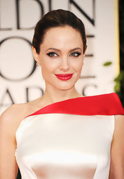 Angelina Jolie wore a vibrant cherry red lipstick at the 69th Annual Golden Globe Awards.