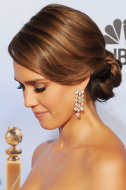 Jessica Alba wore a softly styled romantic updo at the 69th Annual Golden Globe Awards.